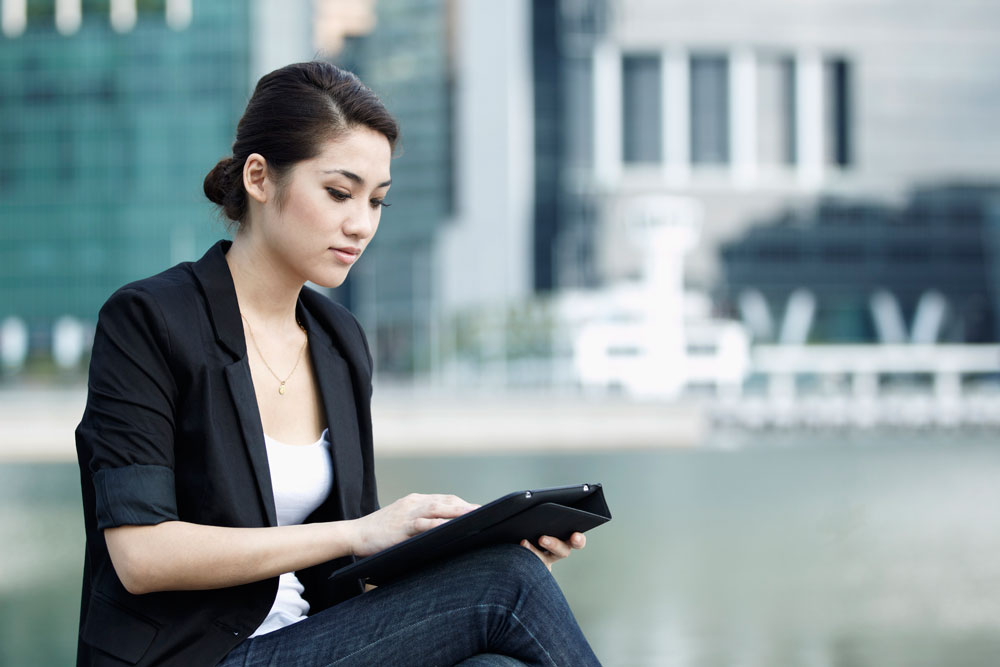photodune-911854-business-woman-using-a-touch-screen-tablet-m